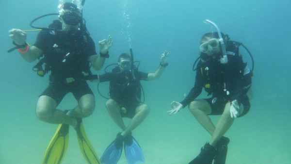 Stef Seb and Simone doing scuba yoga