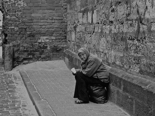 Old lady begging in Riga's Old Town