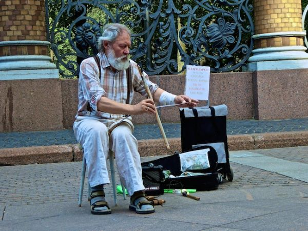 Man playing saw with violin bow