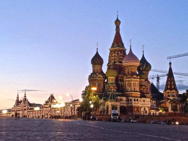 Red Square GUM lit up at night with St Basil's Cathedral
