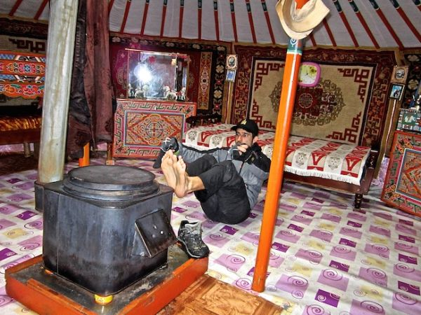 V sits in front of the ger stove to dry off after a wet day of horse riding in the Orkhon valley