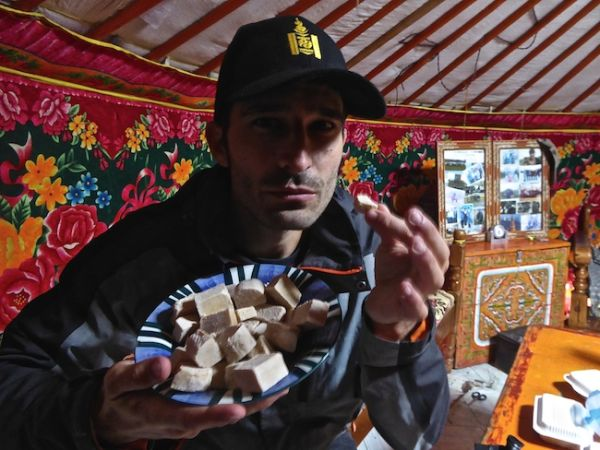 Stefan tucking into dried yak curd treaties at Orkhon valley