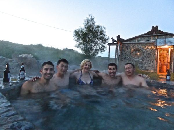Tsenkher hot springs group photo with our guide, driver and fellow travel blogger, Claire travelling with us