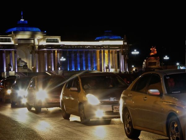 Ulan Bator's evening traffic by the Sukhbaatar square