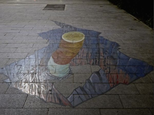 Cigarette stub in Ulan Bator's 3D pavement graffiti