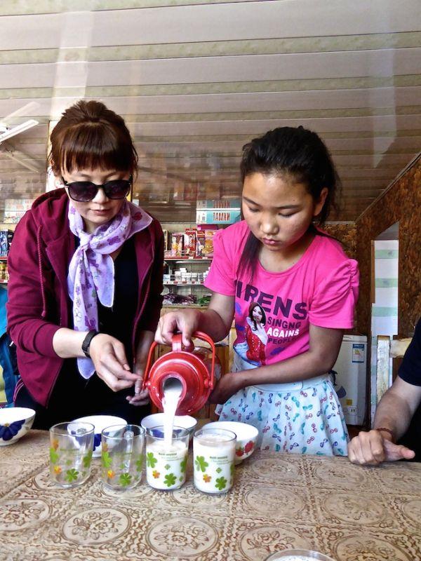 "Trying salted milk tea ""Süütei Tsai"" during our Gobi desert tour"