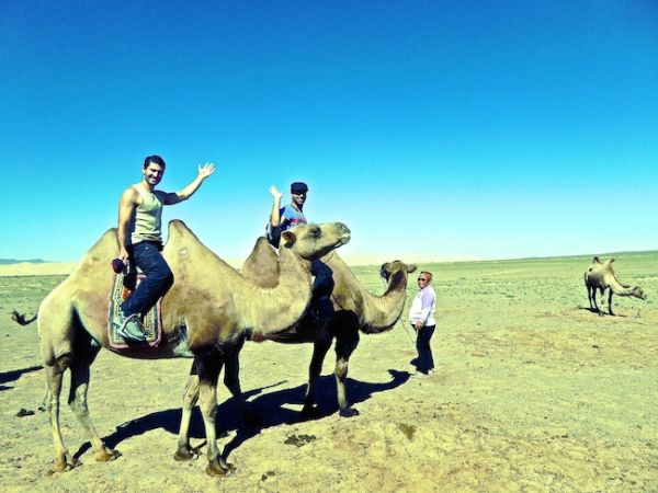 Riding camels through the sand dunes at Khongoryn Els