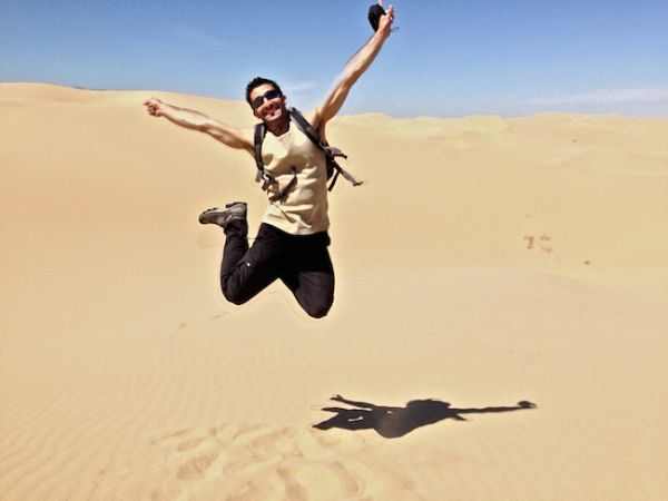 Stef jumping at the Khongoryn Els sand dunes