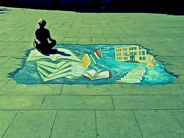 Fellow travel blogger, Claire McHale posing on a 3D pavement graffiti in Ulan Bator