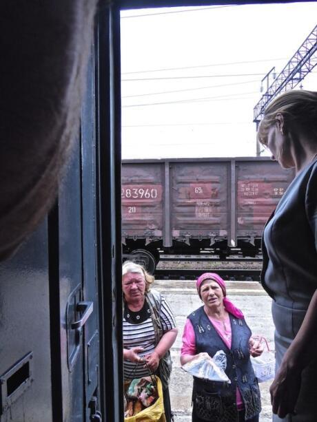 Babushkas selling home made produce at most stops