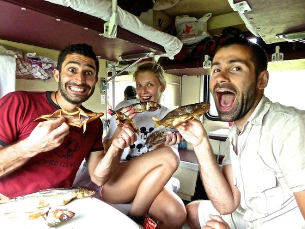 Eating smoked omul on board the Trans Siberian
