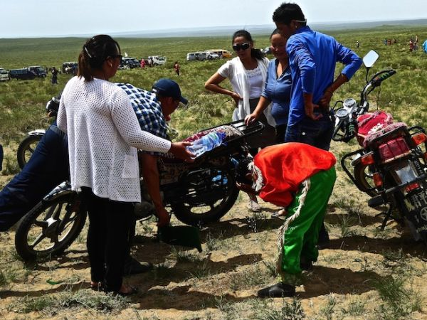 Naadam horse rider washing