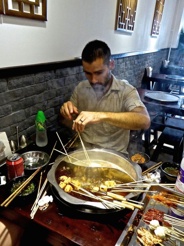 Trying Sichuan hot pot with two broths in Beijing