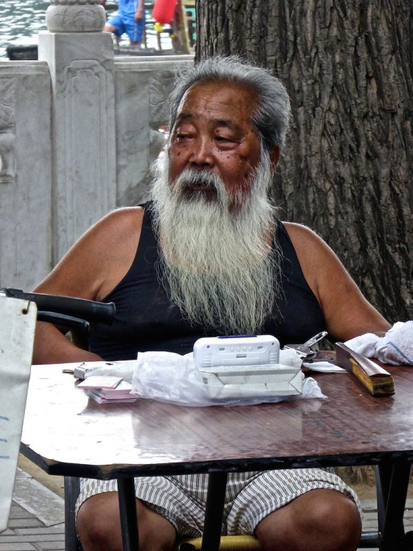 This old man contemplating the day's activities at Nanluoguxiang hutong