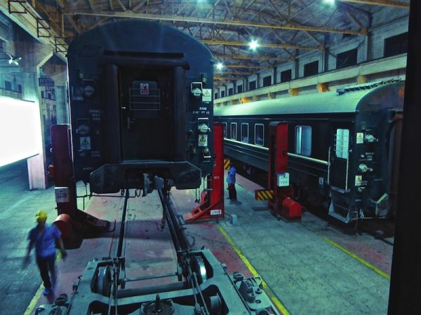 Changing wheels: inserting the smaller Chinese wheels onto the train