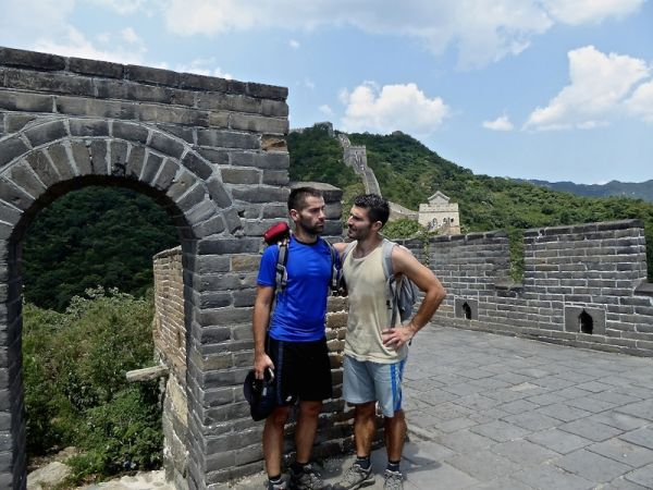 Gay couple travelling in Asia Great Wall of China Mutianyu Beijing