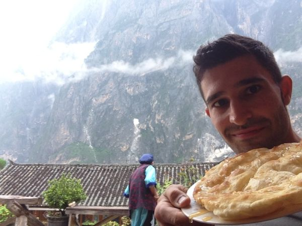 Trying tasty Tibetan baba bread at our guesthouse