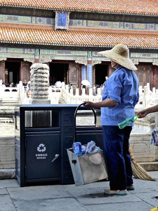 Elderly lady collecting plastic bottles at Beijing's Forbidden City
