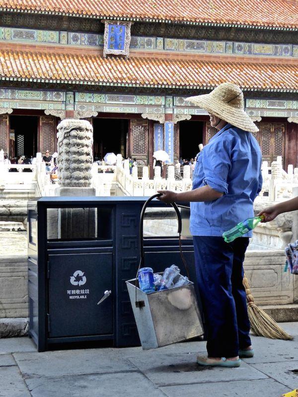 Elderly lady collecting plastic bottles at Beijing's Forbidden City