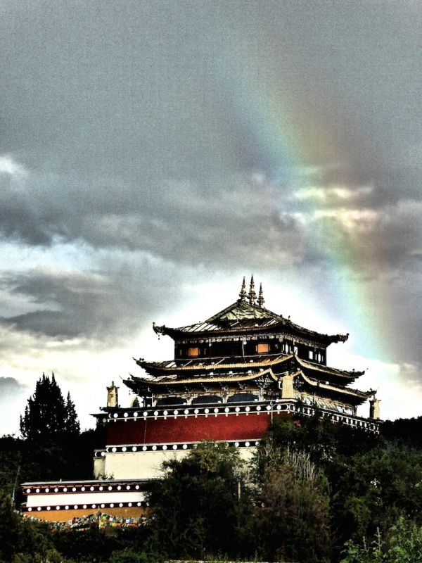 The Guishan Temple with rainbow - like a beacon of hope for Shangri-La