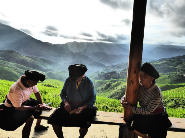 The local old women dressed in their ethnic traditional styles in the Longji rice terraces - Tiantouzhai village