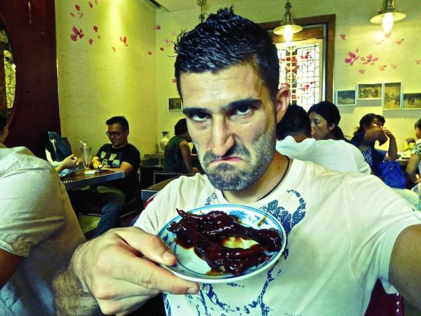 Trying barbecued chicken feet in Shanghai