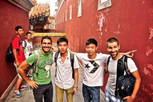 Posing at Beijing's Forbidden City with these excited Chinese school boys