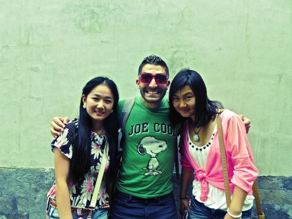 Stefan posing at Beijing's Summer Palace with these two young girls