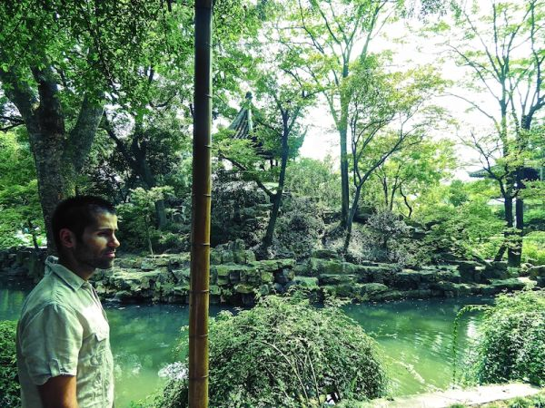 Admiring the beautiful gardens at Suzhou