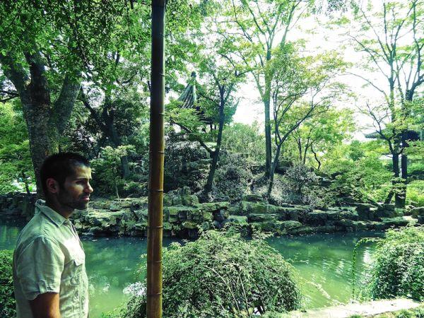 Admiring the beautiful gardens at Suzhou