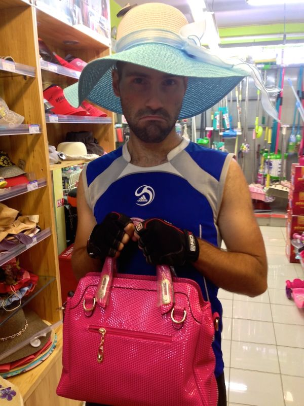 Sebastien upset that he can't fit all his shopping items into his backpack - Dali in Yunnan Province