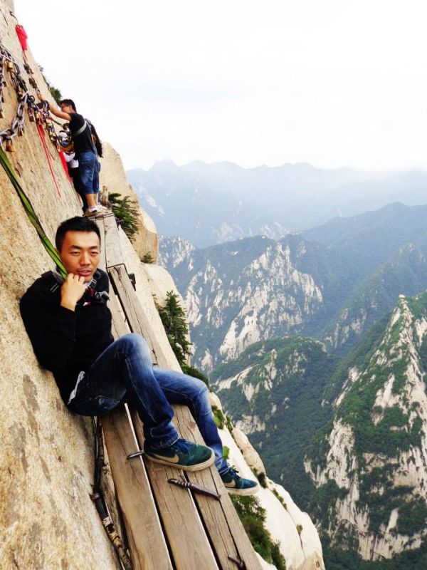 Cass trekking at the cliffside wooden plank path at Hua Shan