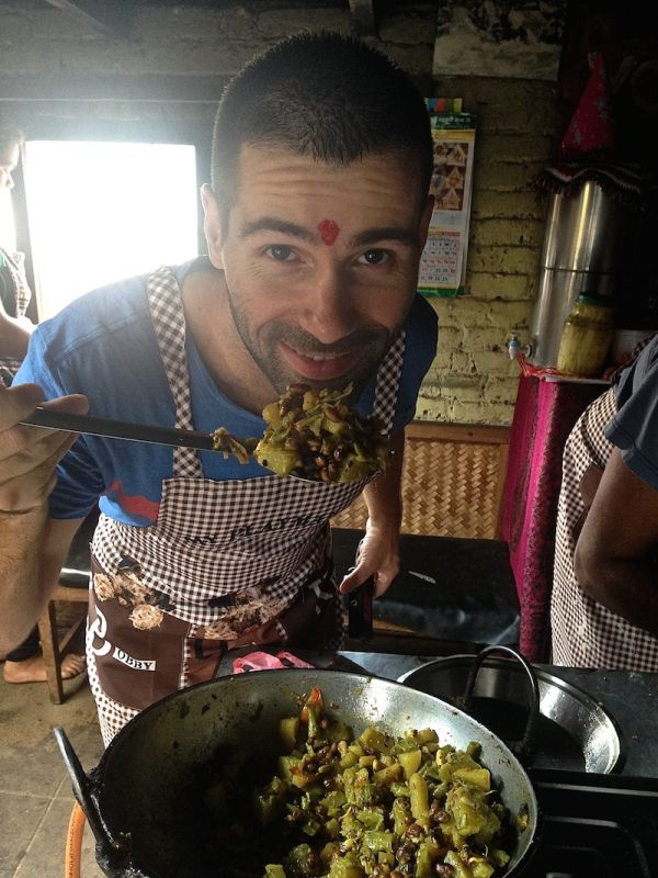 Sebastien showing off the completed vegetable curry