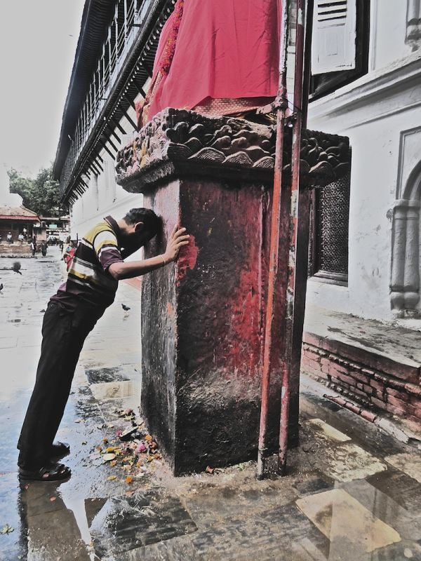 Hindu man praying at a Durbar Square temple