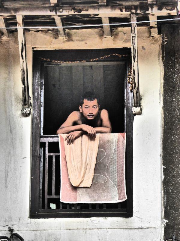 Boy posing from balcony at Durbar Square