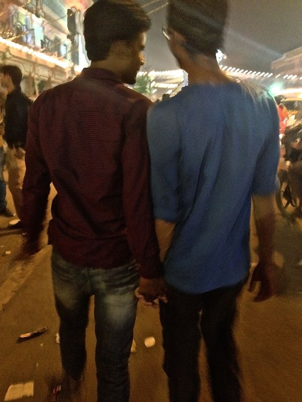 Nepalese boys walking the streets holding hands