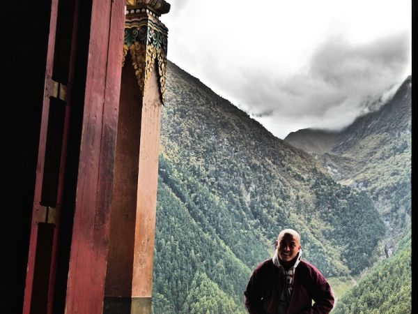 Buddhist monk at the monastery at Upper Pisang village