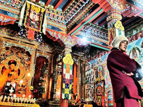 A Buddhist monk showing off this beautiful temple at Upper Pisang village
