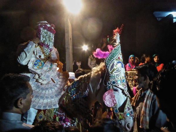 Hate love India Muslim wedding groom going to bride on horse