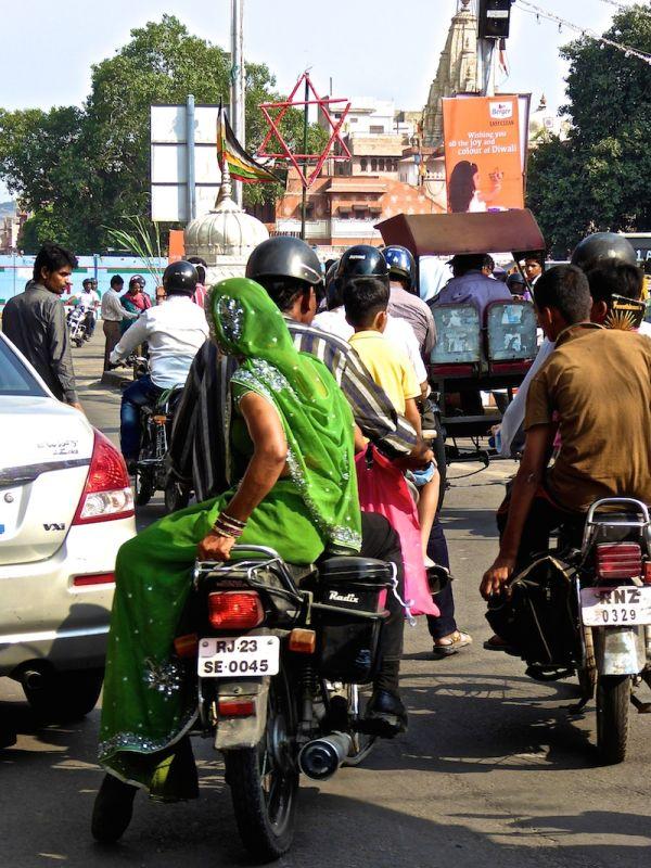 Love hate India traffic woman with sari on motorbike