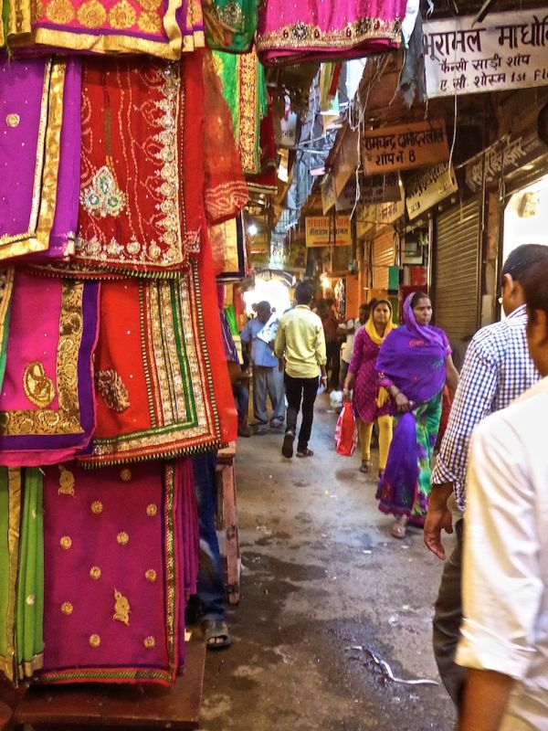 Hate love India beautiful colourful saris Jaipur bazaar