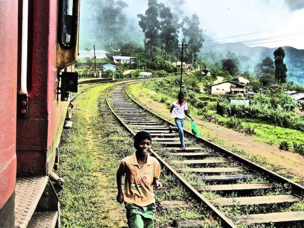 Children running to board our train