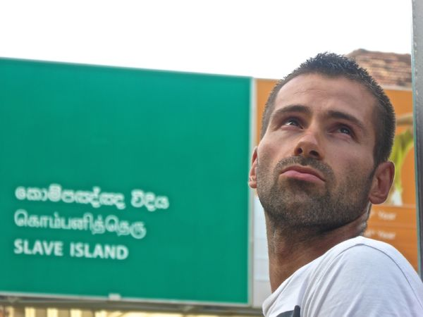 Seb posing by the triple language Slave Island road sign in Colombo