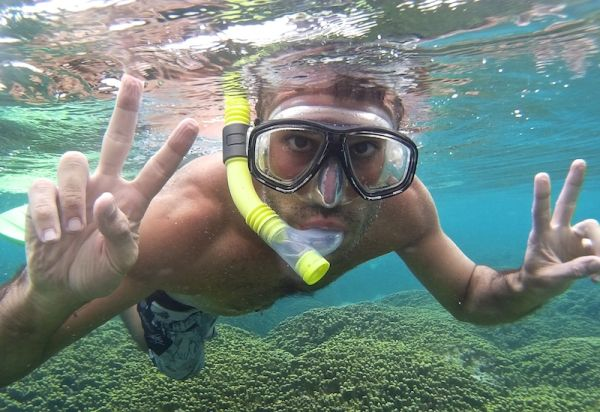 Stefan snorkelling in the house reef of Thoddoo island