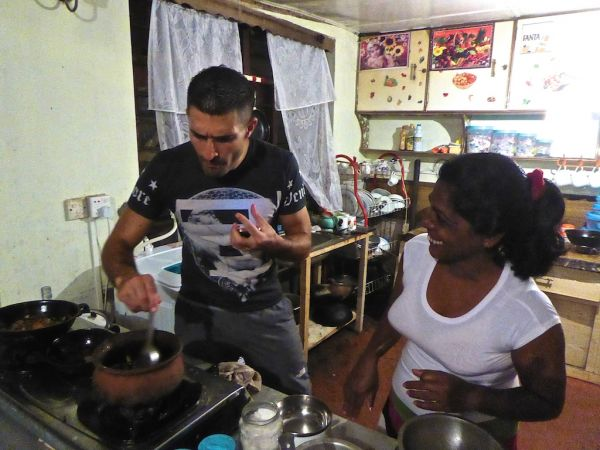 Learning to cook deviled prawns at our home stay in Ella