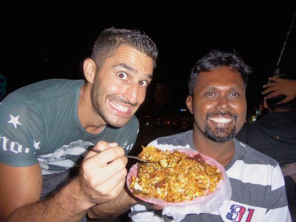 Stefan tucking into a plate of kothu roti