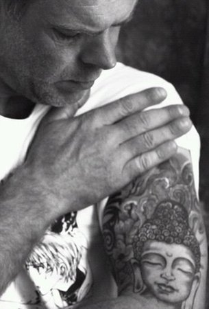 Antony Ratcliffe with his Buddha tattoo