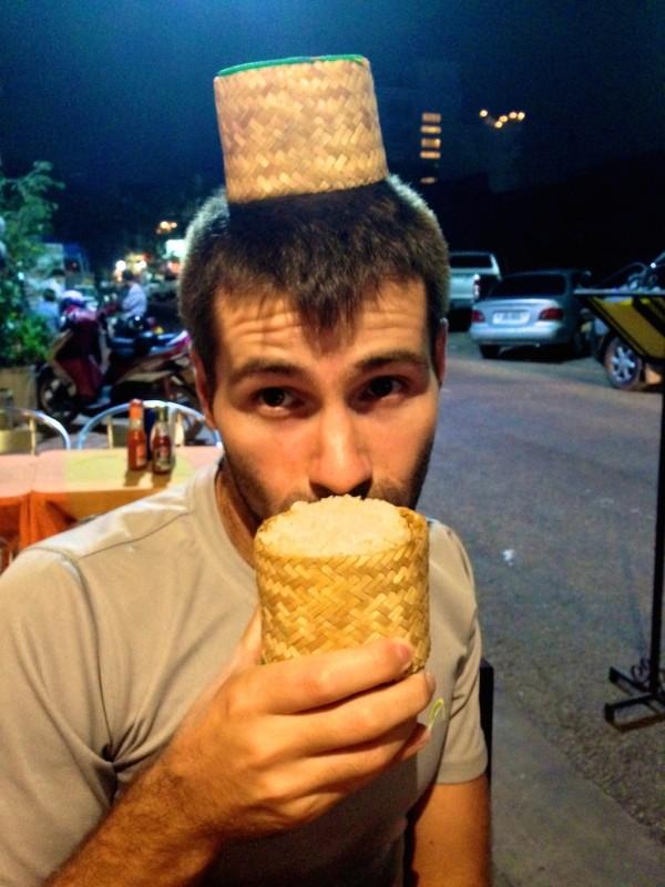 Sebastien discovering sticky rice in Vientiane, Laos