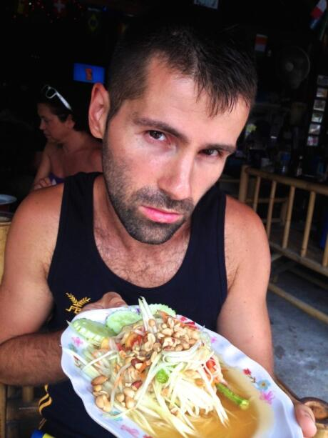 Sebastien with freshly made Thai Papaya salad