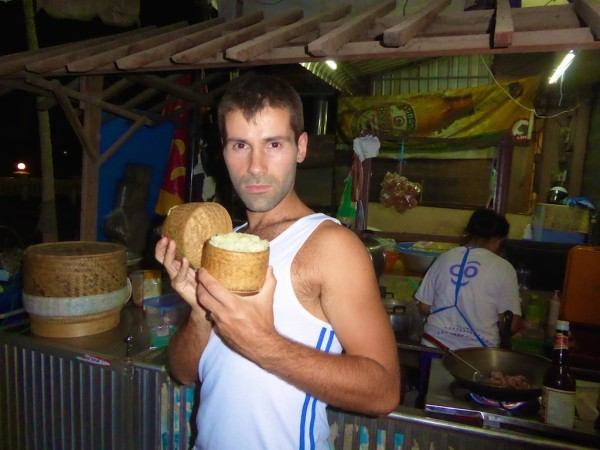 Seb modelling a freshly made bamboo basket of sticky rice in Vientiane